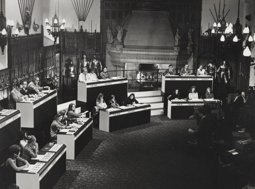 Black and white image of judges at the Eurovision Song Contest at Edinburgh Castle, 1972