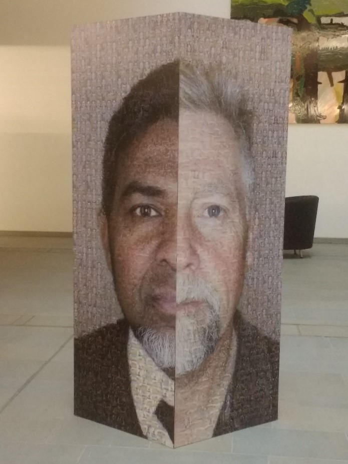 Colour image of a large artwork. Two half faces are depicted, these have been put together to create a single face. Each face is comprised of lots of smaller tiled images.