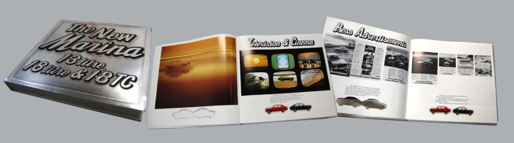 A brochure is spread out on a surface. There is a double-page feature on 'Television and Cinema' and another on 'Press Advertisement'. The pages are illustrated with multiple colour photos, below these text describes an advertisement campaign for a new car called the Marina.